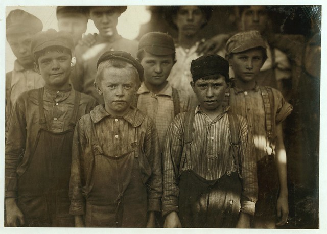 Infants working in Avondale Mills, Birmingham, by Lewis W Hine 1910.