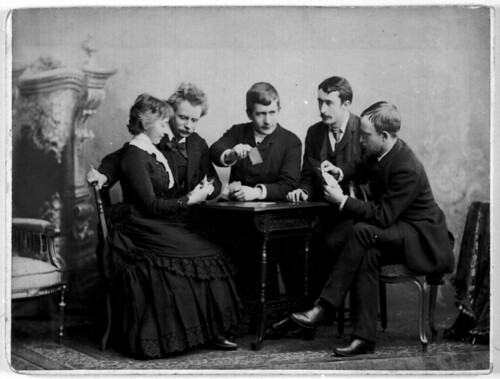 Edvard and Nina Grieg playing cards with three friends