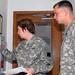 Sgt. David W. Rider and  Sgt. 1st Class Kimberly Ferrante go over his barracks assignment for the competition. by My Army Reserve