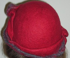 art(0.0), pattern(0.0), magenta(0.0), maroon(0.0), knit cap(0.0), pink(0.0), petal(0.0), textile(1.0), wool(1.0), clothing(1.0), red(1.0), bonnet(1.0), hat(1.0), cap(1.0), woolen(1.0), headgear(1.0),
