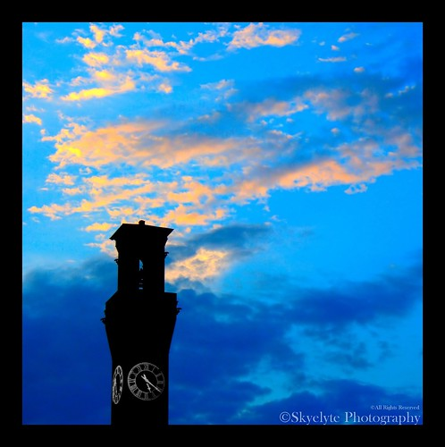 blue sky orange brick tower clock yellow clouds sunrise cityscape canon350d daybreak railroadstation circa1909 waterburyct waterburyunionstation dcp5413