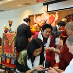Paljor Choedren accepting the blessing cord and image of the deity after drinking nectar from the empowerment, Dilgo Khyentse Yangsi Rinpoche on the throne, Lotus Speech Canada