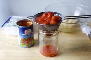 it can help to drain canned tomatoes a little