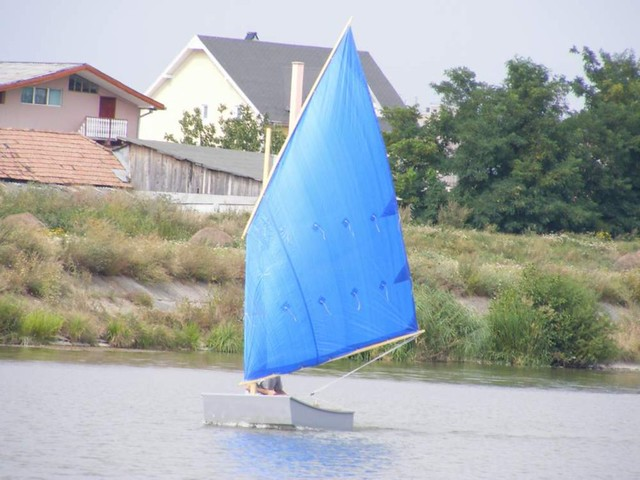 Learn to sail - a well set up cheap sail is way better than a badly set up expensive sail