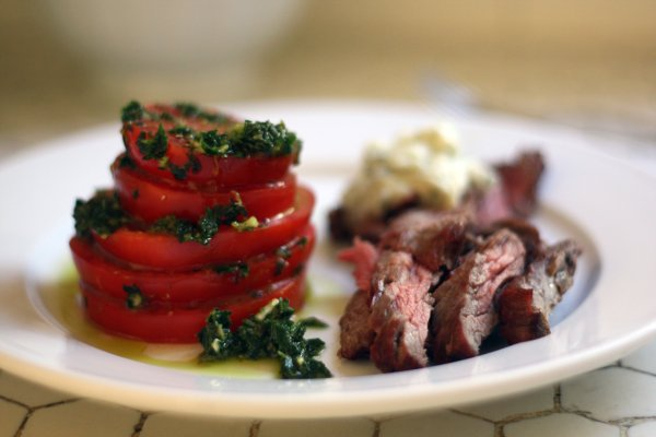 strip steak with blue cheese butter, marinated heirloom tomatoes, and ...