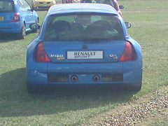 race car(0.0), world rally car(0.0), automobile(1.0), automotive exterior(1.0), renault clio v6 renault sport(1.0), vehicle(1.0), subcompact car(1.0), compact car(1.0), bumper(1.0), hot hatch(1.0), land vehicle(1.0), hatchback(1.0),