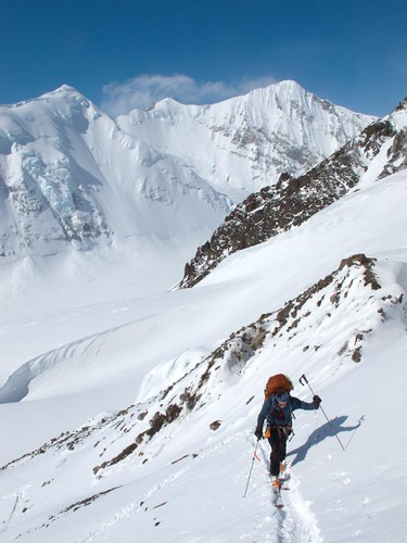 Dylan Taylor climbing moraine above the Middle Fork Glacier toward the Chisana Glacier on a 100-mile ski/hike from Skolai Pass to McCarthy, Wrangell Mountains, Alaska.