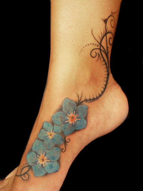 Organic Pattern And Forget Me Not Flowers Tattoo