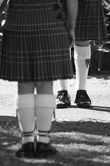 pattern, footwear, clothing, white, shoe, photograph, girl, kilt, monochrome photography, limb, leg, fashion, design, monochrome, black-and-white, black, plaid,