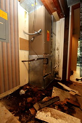 removing soaked particle board from the furnace clos…