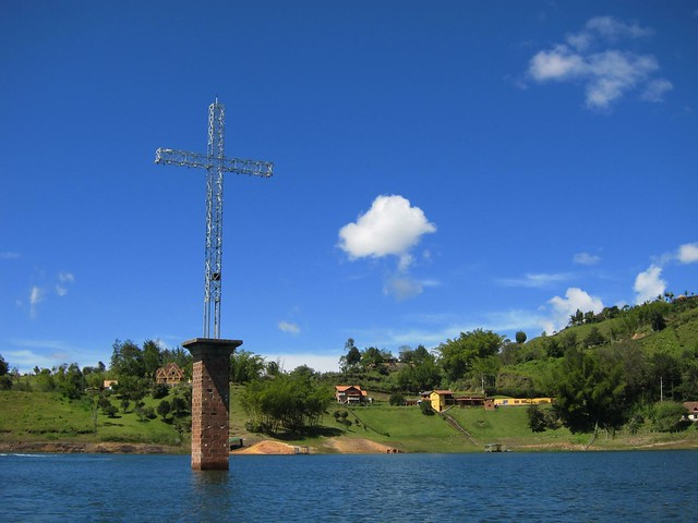 A cross reminds visitors that a pueblo lies below the man-made lake