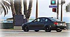 bmw m5(0.0), sports car(0.0), automobile(1.0), automotive exterior(1.0), executive car(1.0), wheel(1.0), vehicle(1.0), automotive design(1.0), sports sedan(1.0), rim(1.0), compact car(1.0), bumper(1.0), bmw 5 series(1.0), sedan(1.0), land vehicle(1.0), luxury vehicle(1.0),