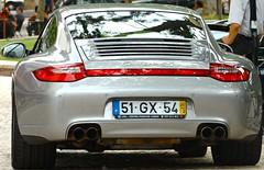 porsche carrera gt(0.0), convertible(0.0), automobile(1.0), automotive exterior(1.0), porsche 911 gt2(1.0), wheel(1.0), vehicle(1.0), performance car(1.0), automotive design(1.0), porsche 911(1.0), porsche(1.0), bumper(1.0), land vehicle(1.0), luxury vehicle(1.0), supercar(1.0),