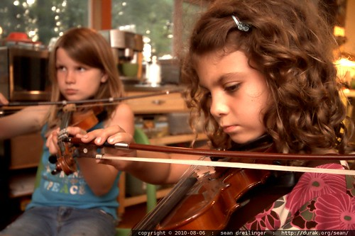 shea and rebecca playing violin with rachel