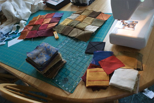 These fabrics are all lightweight drapery or upholstery samples. I had very little of each fabric, and I wanted to get the most of it, so I settled on a combination of pieces that would work well together:  3.5' squares and 4.5' squares.  The 3.5' squares could be sewn into a 4x4 grid, and the 4.5' squares into a 3x3 grid, and they'd all fit together  Blog entry: domesticat.net/2010/08/square-dance