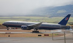 Boeing 777-200 UAL 777 sets down at OGG Maui's main airport - crop +adjust