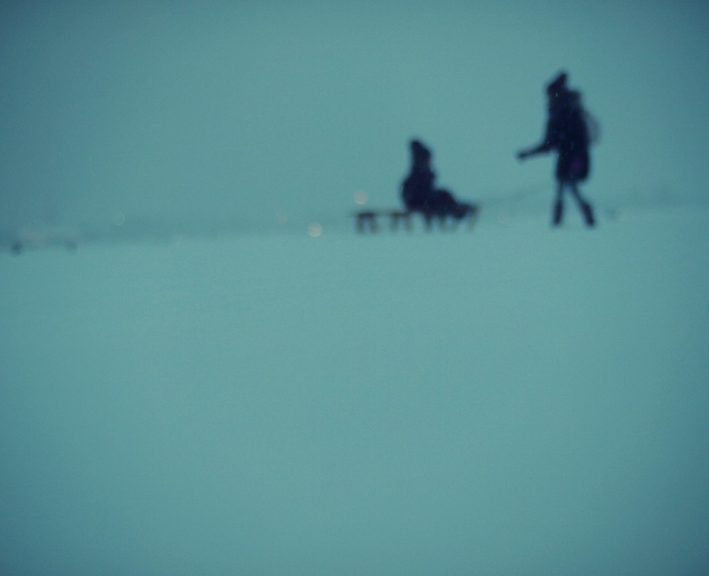 snowy bokeh people (and sledge)