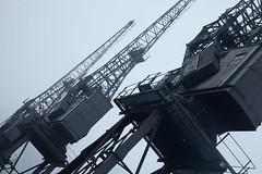 Defunct loading cranes