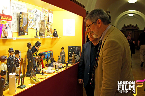 Ray Harryhausen's Myths & Legends Exhibition : John Landis browsing pieces from the Charlie Chaplin Exhibition - London Film Museum by Craig Grobler