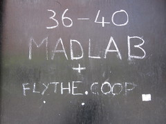 wall(0.0), handwriting(1.0), chalk(1.0), writing(1.0), text(1.0), number(1.0), font(1.0), blackboard(1.0), black(1.0),