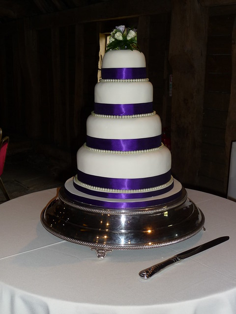 Pearls and Purple Ribbon Wedding Cake 1 This is a 4 tier wedding cake