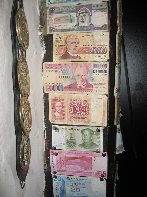 Money from various countries tacked to the wall in the bar at Jamaica Inn
