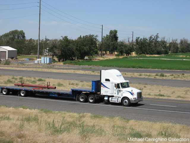 Wal-Mart International 9400 pulling a Stepdeck trailer belonging to the