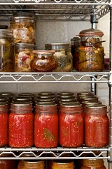 pantry shelves stacked with home-canned jars