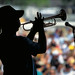 silhouette of Kermit Ruffins in concert