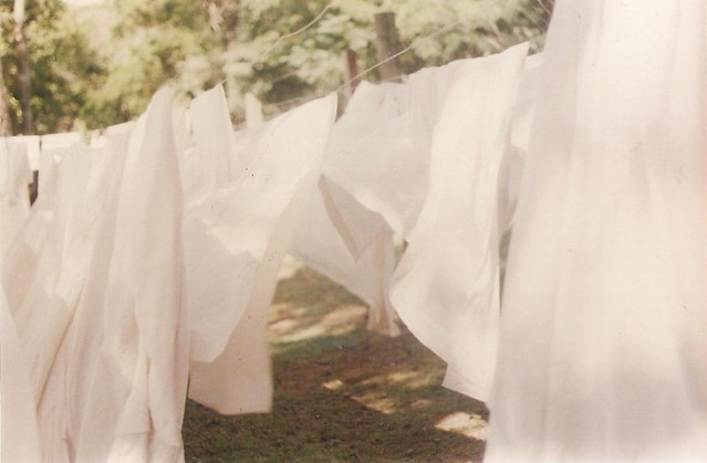 white sheets on a clothes line
