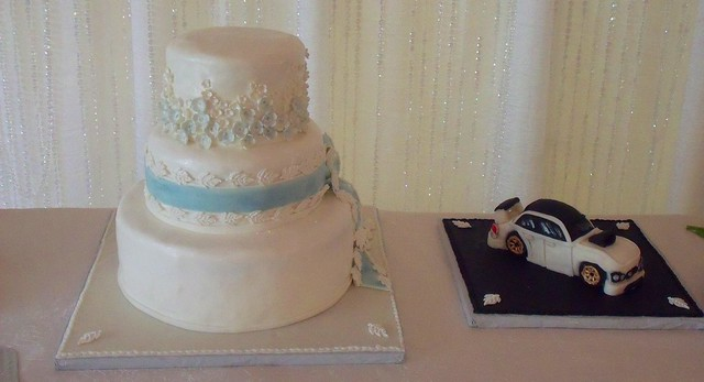 Wedding Cake With Lace Floral Side Design And Groom Car Cake Main