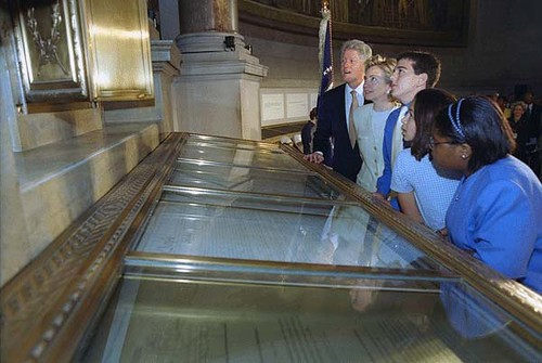 Photograph of President William Clinton and Hillary Rodham Clinton Looking at the Declaration of Independence at the National Archives in Washington, DC , 07/01/1999