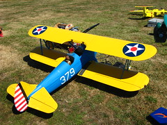monoplane(0.0), flight(0.0), model aircraft(1.0), aviation(1.0), biplane(1.0), airplane(1.0), propeller driven aircraft(1.0), yellow(1.0), wing(1.0), vehicle(1.0), radio-controlled aircraft(1.0), boeing-stearman model 75(1.0), ultralight aviation(1.0), toy(1.0),
