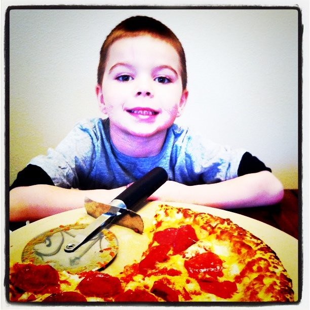 Project 365 34/365: Angry Kid likes the #Freschetta pizza that I got free via @Blissdom. So good cooked on baking stone.
