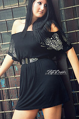 black hair, neck, textile, clothing, abdomen, sleeve, cocktail dress, limb, leg, fashion, trunk, photo shoot, lady, long hair, human body, little black dress, thigh, dress, black,