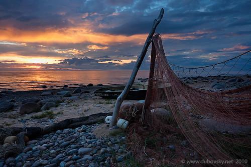 sunset seascape net fisherman dramatic balticsea latvia