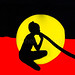 Didgeridoo player on aboriginal flag