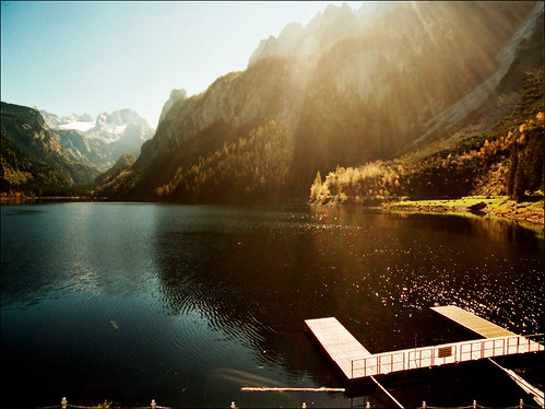 wood travel autumn trees light sunset vacation sky mist mountain lake snow alps reflection green film nature water berg grass fog sunrise landscape geotagged photography austria golden see boat österreich nikon shadows image magic paisaje cielo wallpapers paysage dachstein shining oberösterreich sunbeams autriche gosau salzkammergut gosausee katarinastefanovic katarina2353 gettylicense