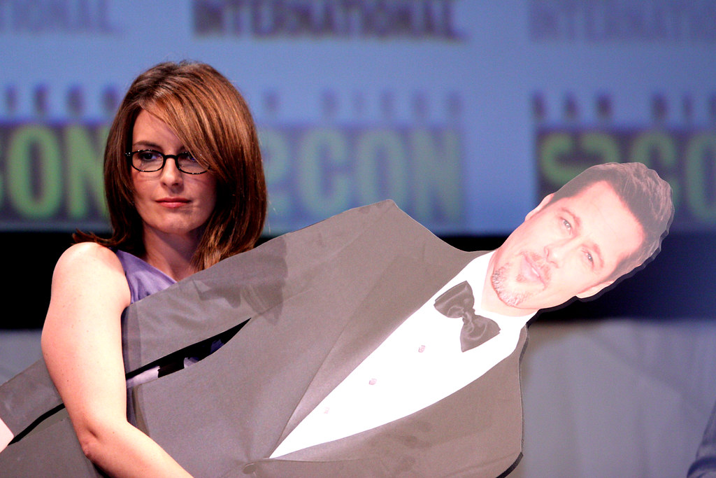 Actress Tina Fey on the MegaMind panel at the 2010 San Diego Comic Con, holding a cardboard cutout of actor Brad Pitt