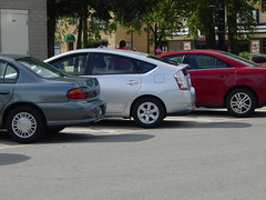 automobile(1.0), automotive exterior(1.0), wheel(1.0), vehicle(1.0), compact car(1.0), bumper(1.0), sedan(1.0), toyota prius(1.0), land vehicle(1.0),