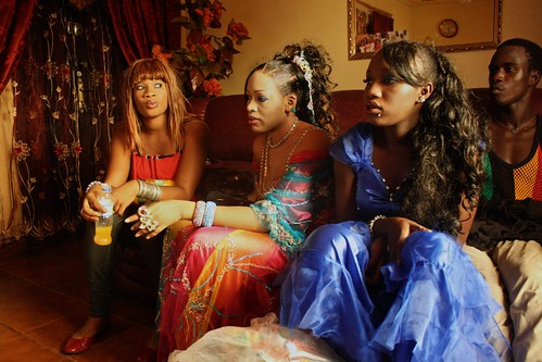 <p>Oumou Sow hangs out with her dancers drinking juice and eating snacks after the show.</p>