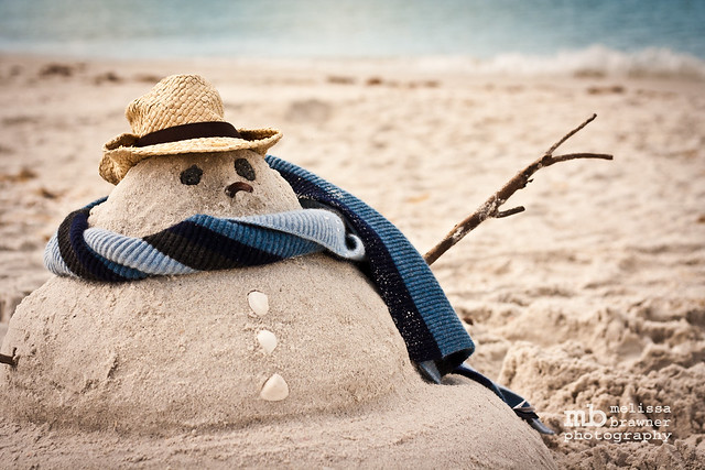 Sand snowman on the beach - Flickr CC Melissa Brawner