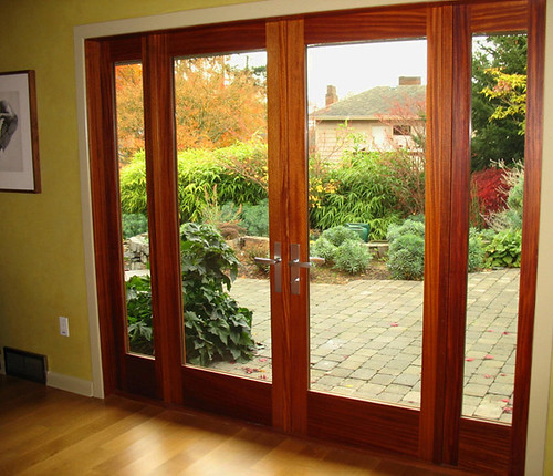 An Interior View Of Custom Mahogany Doors And Sidelights Designed For And Installed In An