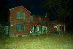 Old abandoned farmhouse at sundown