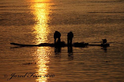china sun fish reflection net nature water silhouette sunrise river boat fishing waves fishermen guilin motor motorboat goldenhour guangxiprovince riverli flickrdiamond sewerdoc ©jaredfein