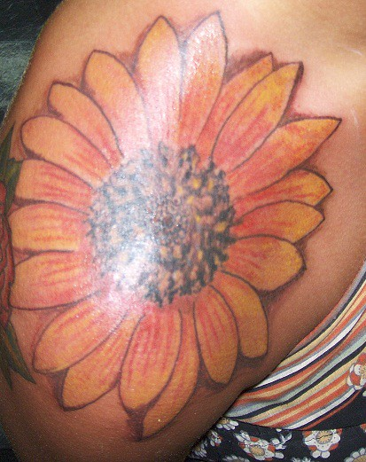 Sunflower on shoulderRealistic Sunflower Tattoo On Shoulder
