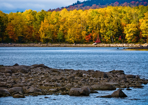Peaceful solace is offered along a lakeshore in the White Mountain National Forest in Maine. It would be difficult for a traveler not to find a site worthy of a great painting or a great photograph. USDA Photo by Bob Nichols.