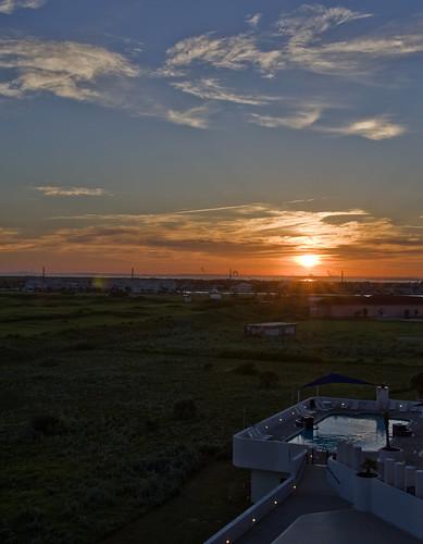 sunset sun pool clouds nikon texas corpuschristi tamron portaransas horwath tamronlens corpuschristibay coastalbend d700 aransasprincess rayhorwath mygearandmepremium tamron28mm300mmlens newportdunesgolfclub