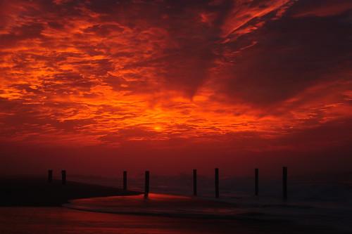 ocean sea clouds sunrise sand nikon hurricane pylon earl blaze nikkor easthampton mainbeach 50mm18d d700 11937 104oceanavenue hurricaneearl