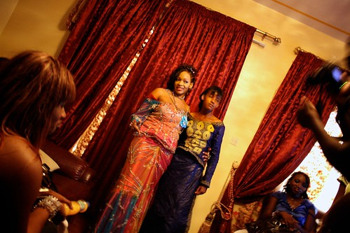"<p>A group of female fans have come to visit Oumou Sow in her home, photographer in tow. Oumou always gives her time and energy to her fans, whom she calls ""Amazones.""</p>"
